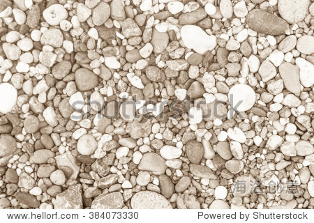 Sea stones laid out in the form of a circle background texture