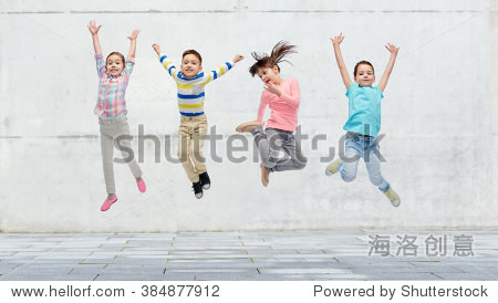 happiness  childhood  freedom  movement and people concept - happy little girl jumping in air over concrete wall on street background