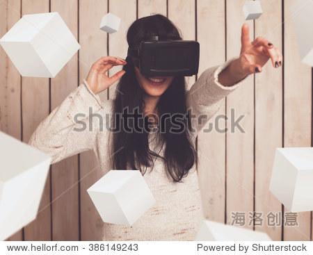 Woman in virtual reality helmet. VR glasses.