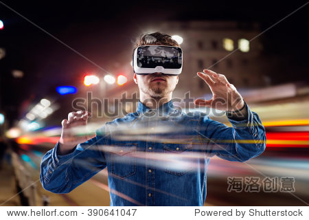 Double exposure  man wearing virtual reality goggles  night city
