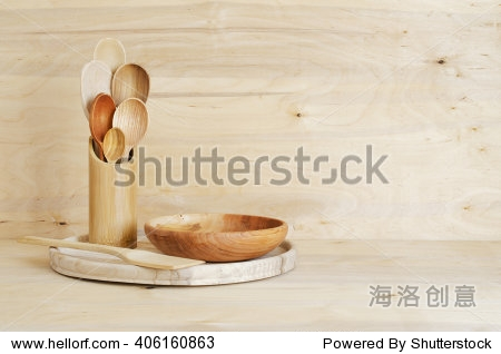 Home Kitchen Decor: wooden cutlery  spoons in a bamboo container on a wooden board background. Cozy arrangement rustic style.