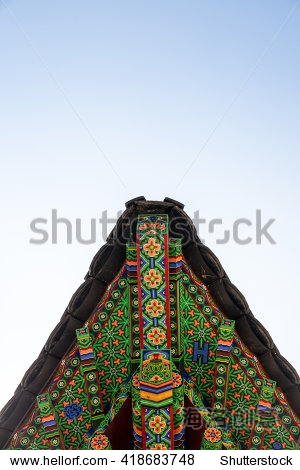 Dancheong is Korean traditional roof.  traditional multicolored paintwork on wooden buildings.