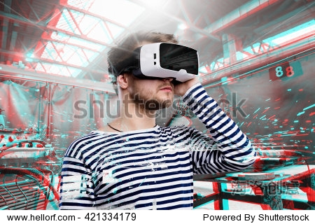 Man wearing virtual reality goggles. Welding factory. VR glasses. 360 degrees. Virtual reality headset. VR game. Wearing virtual reality goggles. Smartphone with VR. Virtual reality video.