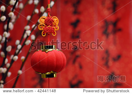 Traditional lantern and Siverbud willow on a festive background.