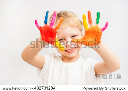 Beautiful child with hands in paint. Portrait of laughing playful kid. Close up of cheerful funny boy isolated on white background. Blond baby portrait ready to make hand prints. Education concept.