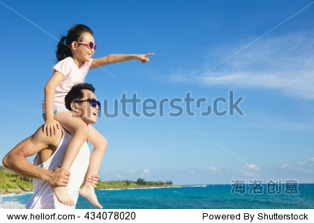 father and Daughter having fun on the beach