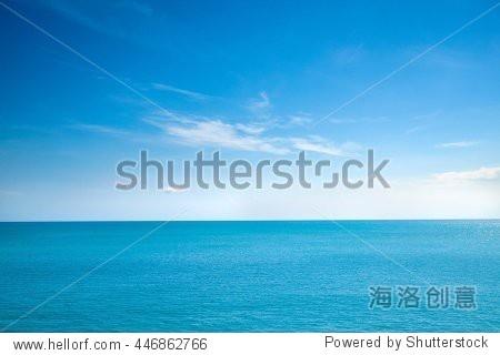 Beautiful white clouds on blue sky over calm sea with sunlight reflection  Bali Indonesia. Tranquil sea harmony of calm water surface. Sunny sky and calm blue ocean. Vibrant sea with clouds on horizon
