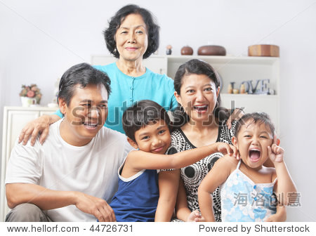 Asian family portrait with their grandmother. PS: stitching image for the tightly crop area of grandma's head make additional height to the image