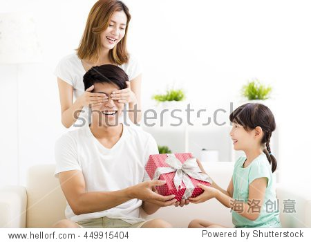 surprised Father receiving gift box from wife and daughter