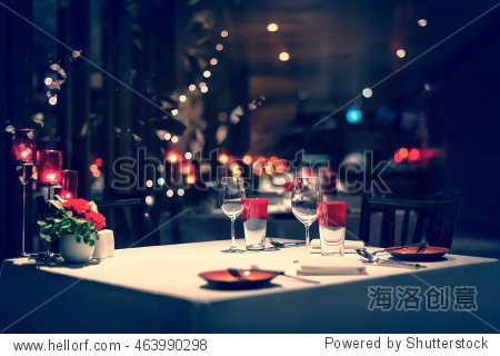 romantic dinner setup  red decoration with candle light in a restaurant. Selective focus. Vintage color.