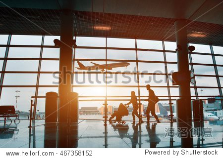 people in airport  silhouette of young family with baby traveling by plane  vacations