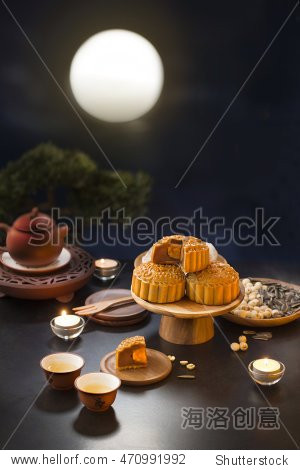 Mid autumn festival mooncake and tea appreciation table top shot with full moon sky background. Shallow depth of field