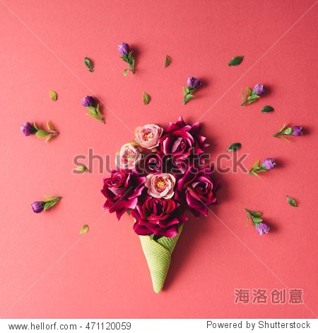 Purple flowers and green icecream cone on pink background. Flat lay.