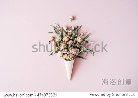waffle cone with roses bouquet on pink background  flat lay  top view
