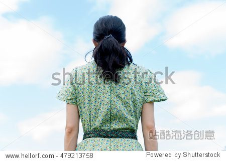Woman on the blue sky background