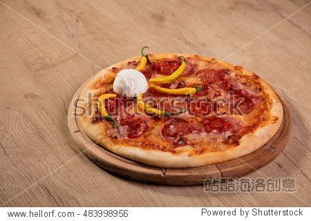 Pizza served on wooden board