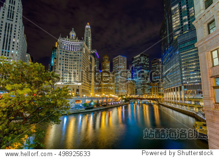 Chicago River skyline with urban skyscrapers at night  IL  USA