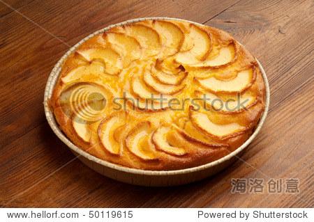 Apple pie  on wood background