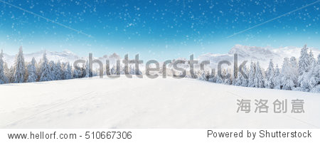 Beautiful winter panorama with fresh powder snow. Landscape with spruce trees  blue sky with sun light and high Alpine mountains on background