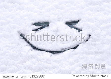 Snow background. Texture of wet snow with a cheerful smiley symbol pattern in the winter window of the car outdoors close-up. Smile in the snow  happy cheerful image.