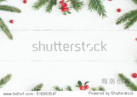 Christmas frame made of fir branches  red berries. Christmas wallpaper. Flat lay  top view  copy space