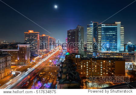 New Arbat Street  highway with moving cars at moony night in Moscow  Russia