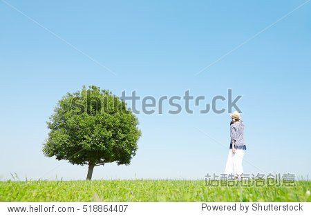 Asian woman walking in the park