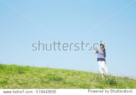 Japanese woman pointing side