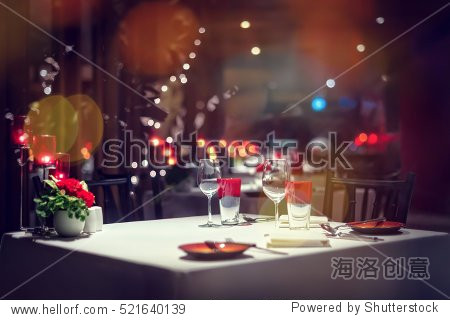 Romantic dinner setup or Holiday table setting  red decoration with candle light.