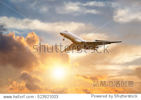 Commercial airplane landing at sunrise