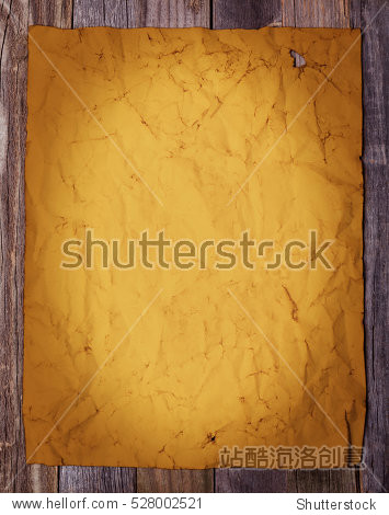 Blank page of golden vintage paper on wooden background