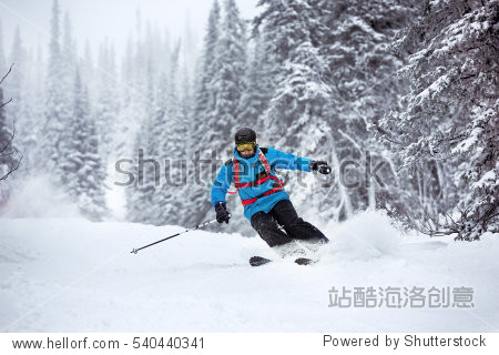 Skier moving very fast in forest. Off-piste slope in Sheregesh ski resort