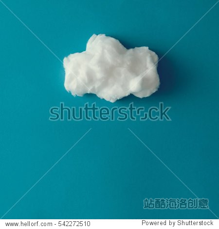 Cloud made out of cotton wool on blue background. Flat lay. Weather concept.