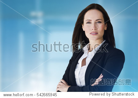 Prestige business woman with crossed arms close up. Advertising image with abstract blue background and copy space.