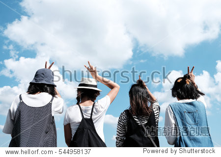 A group of young teenager friends with blue sky background