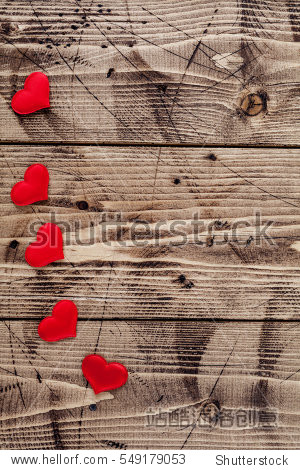 Valentine day wood background with hearts  top view