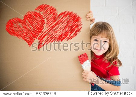 Happy child painting big red heart on the wall. Funny girl playing at home. Valentines day card. Renovation and design concept