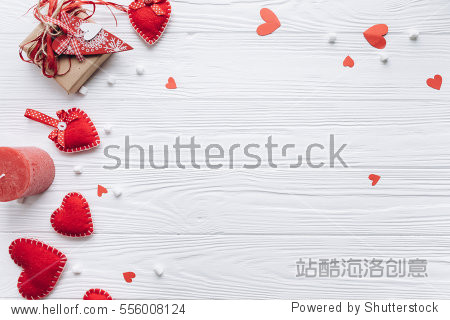 Wooden white background with red hearts  gifts and candles. The concept of Valentine Day.
