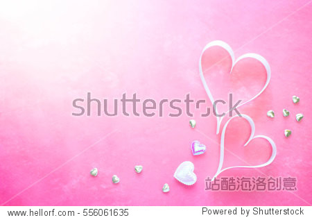 Blur White ribbons shaped as hearts on pink background  valentines day concept.
