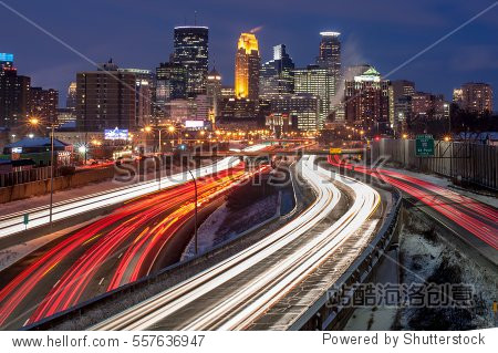 Heavy traffic flowing into Minneapolis on a busy winter evening.