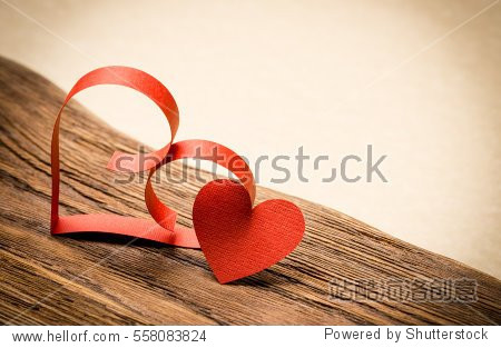 Valentine's Day background. Red heart on old wood