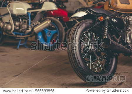 Cropped image of motorcycles in the modern repair shop