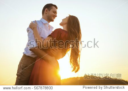 Lovers couple in love having fun dating on beach portrait. Beautiful healthy young girlfriend hugging happy boyfriend  healthy relationship concept