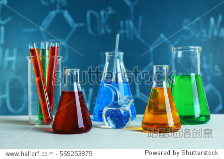 Test tubes and flasks on color background