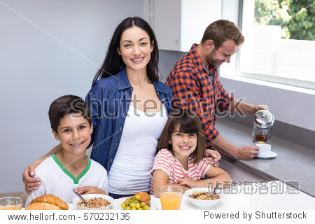 Happy family in the kitchen having breakfast