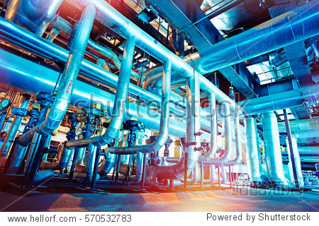 Equipment  cables and piping as found inside of a industrial power plant