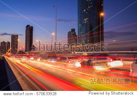 The light trails on the street and urban in the twilight or dusk as city life background.
