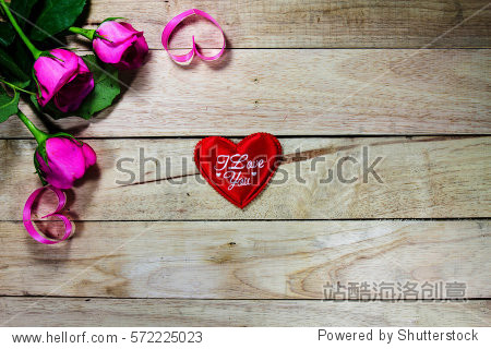 Pink roses with a wooden background Valentine's Day.