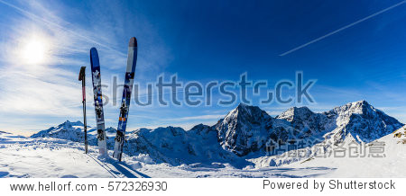 Ski in winter season  mountains and ski touring backcountry equipments on the top of snowy mountains in sunny day. South Tirol  Solda in Italy.