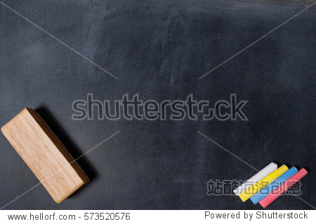 blackboard with colored chalks and eraser. Horizontal composition.